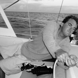 A lazy day at the helm of a sailboat on circumnavigation